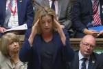 Penny Mordaunt using sign language